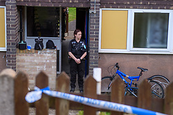 © Licensed to London News Pictures. 16/09/2021. Reading, UK. A police officer maintains a scene watch at the rear entrance of a property in Hadrian Walk East in Whitley, Reading following the discovery of a body in Erith, London on Wednesday 15/09/2021. A murder investigation was launched by Thames Valley Police's Major Crime Unit in connecting with a missing person investigation that was launched on 24/08/2021 following a report that a person had gone missing from the Reading area. Photo credit: Peter Manning/LNP