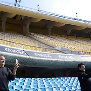 Men take photographs while on a tour of the famous Boca Juniors football stadium, La Bombonera, in La Boca region of Buenos Aires, Argentina, 25th June 2010. Photo Tim Clayton...