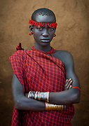 BODI TRIBE FAT MEN<br /> (very) big is beautiful<br /> <br /> Every  year,  takes  place  in the deep south of Ethiopia, in  the <br /> remote  area of Omo valley, the celebration of  the  Bodi  tribe  new <br /> year: the Kael.For  6  months  the  men  from  the tribe will   feed   themselves with only fresh  milk  and  blood  from <br /> the cows. They will not  be allowed to  have sex and to go out of their  little hut.  Everybody will take care of  them, the  girls  bringing  milk  every morning in pots or bamboos. The  winner  is  the  bigger.  He  just <br /> wins fame, nothing special. This  area does not  welcome tourists and has kept his traditions<br /> <br /> Photo shows: The Bodi girls are attracted by the fat men, and it is a good opportunity to show their charms to them.<br /> ©Eric lafforgue/Exclusivepix Media