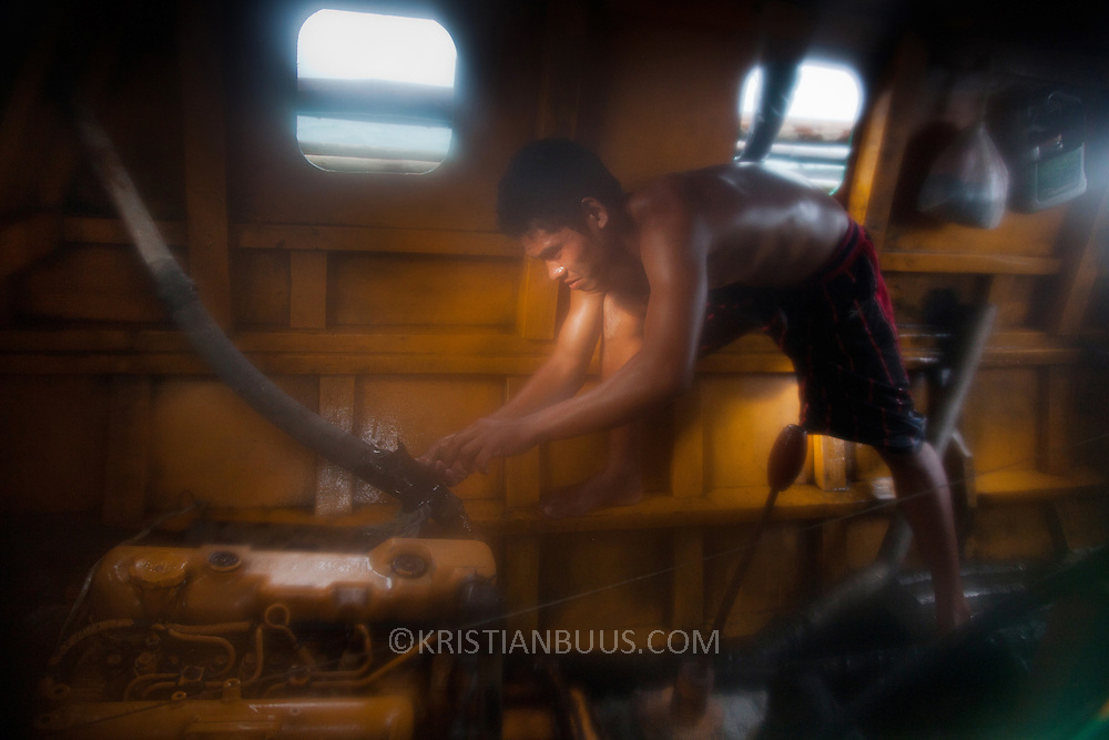RJ tries to fix the leaking pipe with some tape. Joseph is 17 and works like his father did on the sea as a fisherman. The catch of the day is hauled in by the entire crew to be sorted out on deck and taken straight to the market in Hinigaran. The catch that day made the crew $12.00 each( Captain Joan $24.00) One day a week Joseph goes to Alternative Learning schooling provided by Quidan-Kaisahan.  Quidan-Kaisahan is a charity working in Negros Occidental in the Philippines. Their aim is to keep children out of work to secure them education.