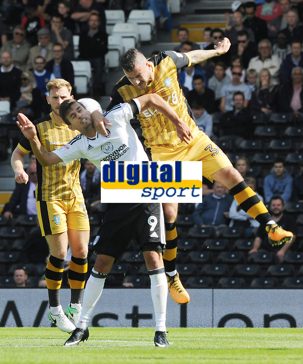 Football - 2017 / 2018 EFL Championship - Fulham vs. Sheffield Wednesday<br /> <br /> Daniel Pudil of Sheffield Wednesday out jumps Rui Fonte of Fulham at Craven Cottage.<br /> <br /> COLORSPORT/ANDREW COWIE