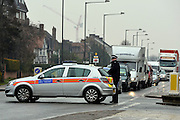 © Licensed to London News Pictures. 09/04/2013. London, UK Police hold traffic so the container can be moved into position. Boxes are loaded into a shipping container from the North Korean Embassy in Ealing London today 9th April 2013. On Friday North Korea warned it would not be able to guarantee the safety of embassy staff in their country in the event of a war. Photo credit : Stephen Simpson/LNP