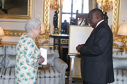 Queen Elizabeth II shows South African President Cyril Ramaphosa letters between her and Nelson Mandela on South Africa returning to the Commomwealth which was presented as a gift to him during an audience at Windsor Castle, Berkshire.