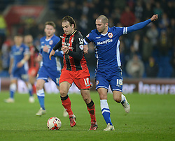 Bournemouth's Brett Pitman battles for the ball with Cardiff City's Matthew Connolly - Photo mandatory by-line: Alex James/JMP - Mobile: 07966 386802 - 17/03/2015 - SPORT - Football - Cardiff - Cardiff City Stadium - Cardiff City v AFC Bournemouth - Sky Bet Championship