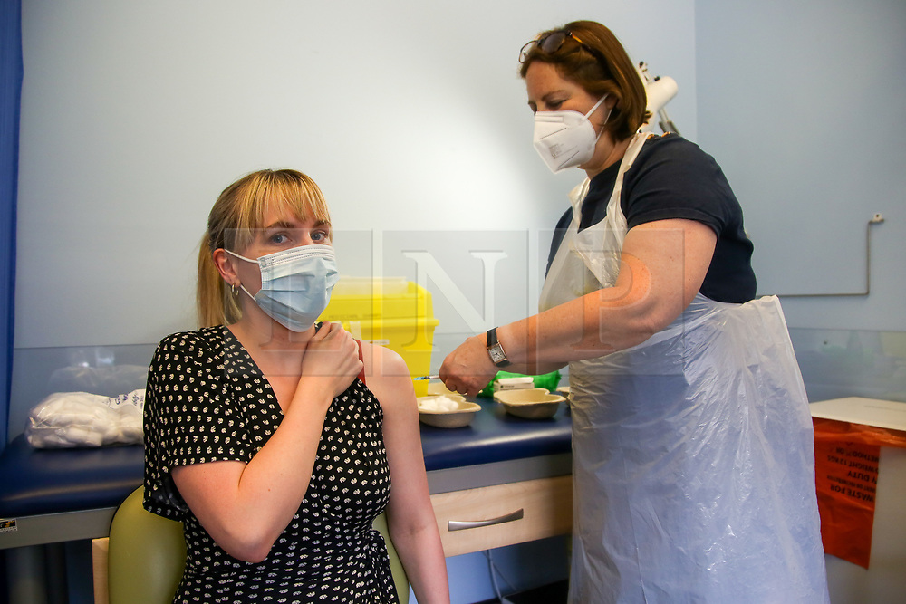 © Licensed to London News Pictures. 15/06/2021. London, UK. Vaccinator Shelley Salter administers the first dose of Pfizer Covid-19 vaccine to Gemma Jones at a vaccination centre in Haringey, north London. <br /> All over-18s in England should be able to book their Covid-19 vaccination by the end of this week. More than 60 million doses of coronavirus vaccine have been administered in England, according to NHS England data. Photo credit: Dinendra Haria/LNP