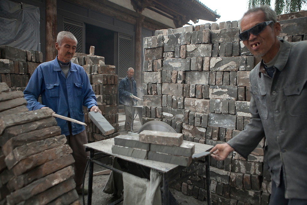 Workers shaping the traditional looking bricks.