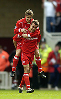 Photo. Jed Wee.<br /> Middlesbrough v Southampton, FA Barclaycard Premiership, The Riverside, Middlesbrough. 12/04/2004.<br /> Middlesbrough's Juninho leaps onto the shoulders of Szilard Nemeth after opening the scoring.