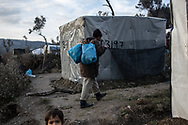 A man is seen carring wood to a makeshift backery inside the camp. About 20000 are living in a makeshift camp nearby the city of Moria on the island of Lesbos in miserable conditions, most of the without water, electricity nor sanitary facilities.  Federico Scoppa