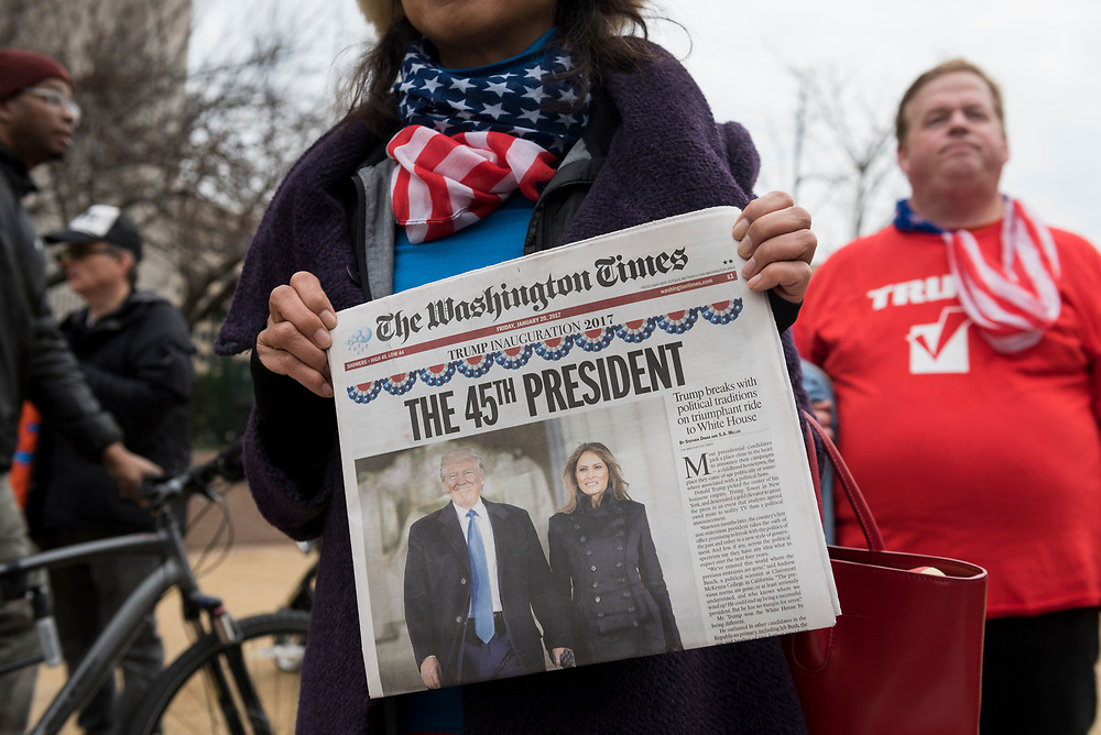Marissa Rivero, of Silver Spring, MD, holds the day's edition of The Washington Times.<br /> <br /> (Washington D.C. - January 20, 2017)