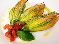 Stuffed zucchini or courgette blossoms