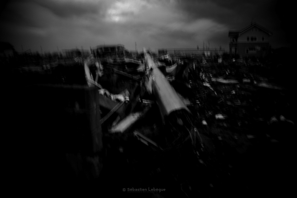 Ishinomaki (Tohoku Japan) has been destroyed by the tsunami on 11th march 2011. The photographs of this subjective series, in which I aspired to higher cognition than mere sight, show people and the ruined neighbourhood trought a opaque infrared filter..By willingly obscuring visual perception, the images are an expression of a highly personal, disquieting interpretation of the desolation.