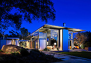 """Montecito Residence by Barton Myers Associates.<br /><br />The Montecito Residence is situated on a 1-acre site in an environmentally sensitive habitat with dense vegetation and large boulders.The program includes a 3,000 sf main residence, 500 sf garage and a 50' lap pool. The main residence is broken up in two wings: one includes the living and kitchen areas and the second includes the bedroom, bathrooms and library.<br />The intention behind the design strategy is tectonic design research that creatively envisions a flexible prototype for mass-produced housing using steel construction and standardized off-the-shelf industrial components. Since a majority of all steel is manufactured from scrap metals from recycled automobiles it is a """"green"""" material. The design advances concepts of adaptive space while creating a """"kit of parts"""" that can be assembled into 12-foot modules as an alternative to the manufactured buildings mitigating the unpredictable link of manufactured units to serviced land. This residential design is the fourth iteration in an ongoing research project initiated in 1970.<br /><br />Text ©Barton Myers Associates, Inc.<br /><br />http://www.bartonmyers.com/"""