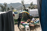 Children living in the makeshift settlement next to the official Moria refugee camp site is home to an estimated 1500 asylum seekers. Scattered amongst the olive groves, people live in tents and shelters in this unofficial site.