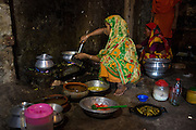 Curry being cooked in a communal kitchen where lots of garment workers live in Dhaka Bangladesh.