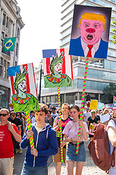 © Licensed to London News Pictures. 13/07/2018. London, UK. Thousands of protesters march through central London as President of the United States of America Donald Trump continues his visit to the United Kingdom. Photo credit: Rob Pinney/LNP