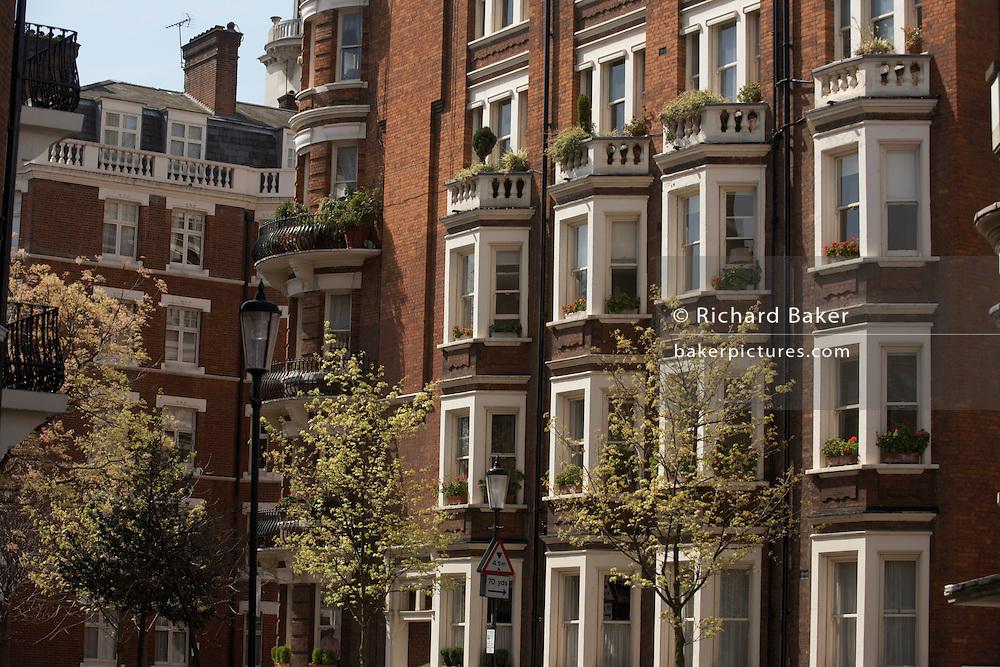 Handsome red brick architecture of Victorian properties in D'Oyley Street, London's Belgravia, SW1