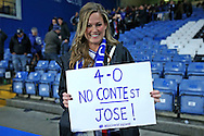 """a Chelsea fan with taunts their old manager after full time as she holds up a sign saying """"4-0 No CONTEst JOSE! #WELCOMEHOME"""" . Premier league match, Chelsea v Manchester Utd at Stamford Bridge in London on Sunday 23rd October 2016.<br /> pic by John Patrick Fletcher, Andrew Orchard sports photography."""