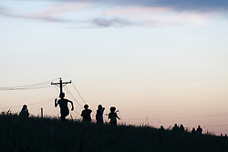 People hiking on levee along Trinity River, Dallas, Texas, USA