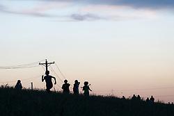 People hiking on levee along Trinity River, Dallas, Texas, USA