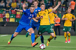 VILNIUS, June 11, 2017  Vykintas Slivka (R) of Lithuania vies with Filip Kiss (L) of Slovakia during the FIFA World Cup European Qualifying Group F match between Lithuania and Slovakia at LFF Stadium in Vilnius, Lithuania on June 10, 2017. Slovakia won 2-1. (Credit Image: © Alfredas Pliadis/Xinhua via ZUMA Wire)