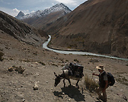 """Above the Wakhan river. Trekking from Shaur camp across Baharak, to the valley of Sang Nevishta (meaning """"Written Stones""""). Guiding and photographing Paul Salopek while trekking with 2 donkeys across the """"Roof of the World"""", through the Afghan Pamir and Hindukush mountains, into Pakistan and the Karakoram mountains of the Greater Western Himalaya. Wakhan Corridor."""