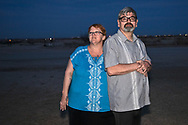 Penny Aucoin, Carl George outside of their home in New Mexico's Permian Basin.