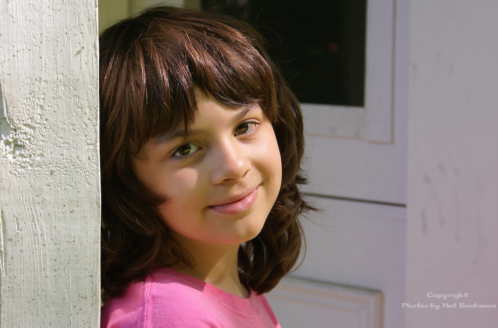 A portrait of a young girl in the early morning light.