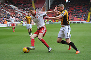 Sheffield United midfielder Chris Basham under attack from Carl Dickinson of Port Vale during the Sky Bet League 1 match between Sheffield Utd and Port Vale at Bramall Lane, Sheffield, England on 20 February 2016. Photo by Ian Lyall.