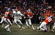 "CLEVELAND, OH-JANUARY 11:  NFL Hall of Fame quarterback John Elway scrambles with the ball during his famous ""The Drive"" game during the AFC Championship against the Cleveland Browns at Municipal Stadium, Cleveland Ohio on January 11, 1986.  Elway played for the Denver Broncos from 1983-1999.  (Photo by Ron Vesely)"