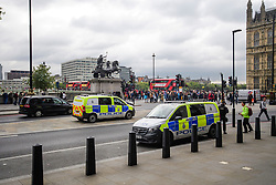 © Licensed to London News Pictures. 16/09/2017. London, UK. Two police vans containing armed police officers watch over at Westminster Bridge in London, the day after a bomb partly exploded on a tube train at Parsons Green station in London injuring members of the public. Operation temperer has been put in to place after the UK terror threat level was raised to critical. Photo credit: Ben Cawthra/LNP