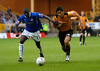 Photo: Richard Lane.<br /> Wolves v Leicester City. Coca Cola Championship.<br /> 17/09/2005.<br /> Wolves' Seol Ki-Hyeon attacks as Leicester's Stephen Hughes challenges.