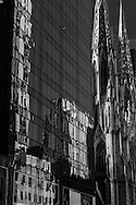 New York. Saint Patrick cathedral , mirror game on a building,  of fifth avenue.  New York, Manhattan - United states