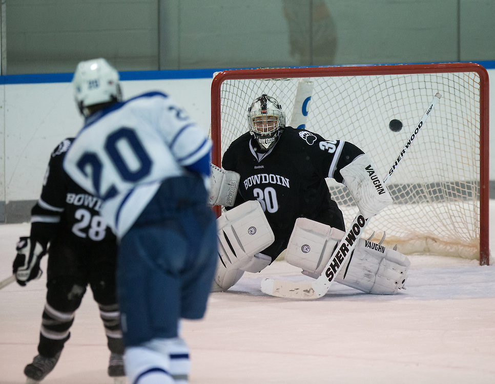 Max Fenkell of Bowdoin College makes a save during an NCAA Division III college hockey game between Colby College and Bowdoin College at Alfond Rink at Alfond Arena, Saturday Dec. 1, 2012 in Waterville, ME. (Dustin Satloff/Colby College Athletics)