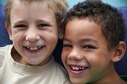 Portrait of two young boys laughing,