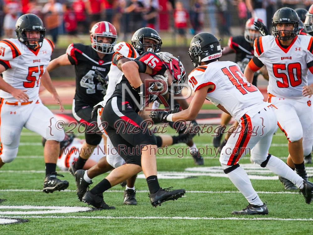 Traevon Edmundson (#5) working to bring the Broncos Hayden White (#15)