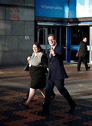 Conservative Party Conference, ICC, Birmingham, Great Britain <br /> Day 3<br /> 9th October 2012 <br /> <br /> Rt Hon David Cameron MP<br /> Prime Minister <br /> outside conference centre with Jessica Lee MP <br /> <br /> <br /> <br /> Photograph by Elliott Franks<br /> <br /> United Kingdom<br /> Tel 07802 537 220 <br /> elliott@elliottfranks.com<br /> <br /> ©2012 Elliott Franks<br /> Agency space rates apply