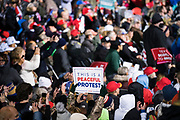 Crowds hold signs during a 'Make America Great Again' rally in Duluth, Minnesota, U.S. on Wednesday, Sept. 30, 2020. Trump and Democratic nominee Joe Biden began their first debate on an acrimonious note and quickly made it personal, with each candidate interrupting and talking over each other. Photographer: Ben Brewer/Bloomberg