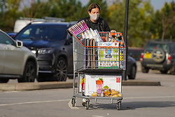 © Licensed to London News Pictures. 1/11/2020. Sheffield, UK.  A shopper wearing a face covering pushes her trolley after shopping at Costco in Sheffield, South Yorkshire. British Prime Minister Boris Johnson announced a new four week lockdown across England, from Thursday 5 November, to contain the spread of covid-19.  Photo credit: Ioannis Alexopoulos/LNP