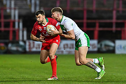 11th November 2018 , Racecourse Ground,  Wrexham, Wales ;  Rugby League World Cup Qualifier,Wales v Ireland ; Elliot Kear of Wales is tackled by Ethan Ryan of Ireland <br /> <br /> <br /> Credit:   Craig Thomas/Replay Images