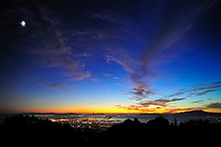Sunset view of San Francisco and Oakland from the Berkeley Hills. Composite of 3 images taken with a Nikon D3x camera and 24 mm f/2.8 PC-E lens (ISO 800, 24 mm, f/5, 0.5 sec).