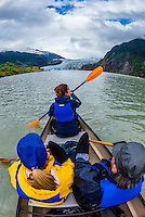 Canoeing on Mendenhall Lake with Mendenhall Glacier in background, Juneau, Alaska USA.