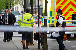 © licensed to London News Pictures. London, UK 14/04/2014. The scene in London's Grosvenor Square where part of a building collapsed and killed a man on Monday afternoon of April 14, 2014. Photo credit: Tolga Akmen/LNP