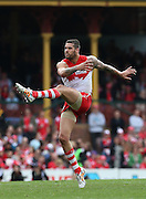 Lance Franklin of the Swans kick a goal during the 2014 AFL Round 21 match between the Sydney Swans and the St Kilda Saints at the SCG, Sydney on August 16, 2014. (Photo: Craig Golding/AFL Media)