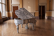 A piano wrapped in lace by the Portuguese artist Joana Vasconcelos. Part of an exhibition of hers at The Haunch of Venison Gallery, London.