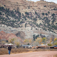 103013       Brian Leddy<br /> Kevin Yazzie walks home along Church Rock Street Wednesday afternoon. Yazzie lives in Sundance.