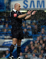 Photo: Ed Godden.<br />Chelsea v Fulham. The Barclays Premiership. 30/12/2006.<br />Referee Howard Webb stands in the torrential rain.