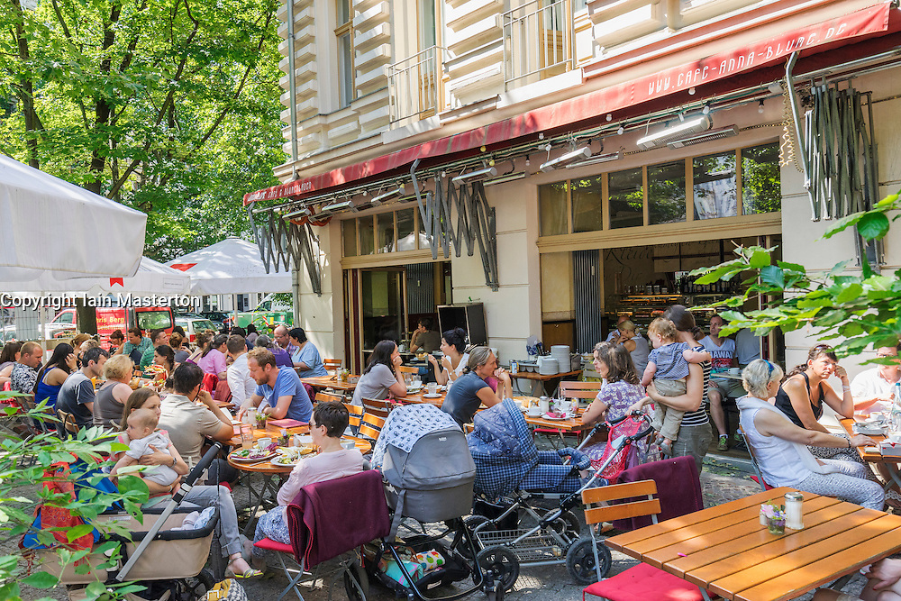 Busy Anna Blume cafe in summer in Prenzlauer Berg district of Berlin Germany