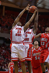 "31 January 2009: Kellen Thornton and Osiris Eldridge reach for a loose ball. The Illinois State University Redbirds join the Bradley Braves in a tie for 2nd place in ""The Valley"" with a 69-65 win on Doug Collins Court inside Redbird Arena on the campus of Illinois State University in Normal Illinois"