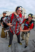 From right, Erik Roner of Nitro Circus assists Travis Pastrana as he prepares his parachute prior to base jumping off The Signature at the MGM Grand Hotel & Casino on Wednesday June 1, 2011 in Las Vegas to promote the North American debut of Nitro Circus Live at the MGM Grand Garden Arena on Saturday June 4, 2011. (Jeff Bottari/AP Images for Nitro Circus Live)