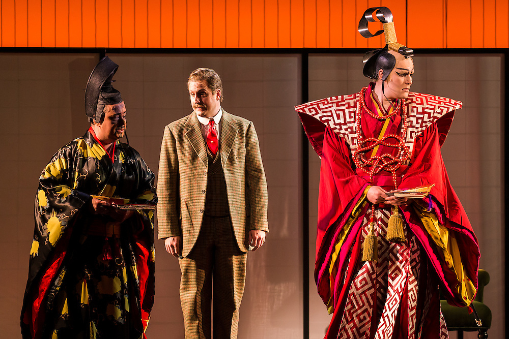 """LONDON, UK, 14 May, 2016. Left to right: Alun Rhys-Jenkins (as Goro), George von Bergen (as Sharpless) and Matthew Durkan (as Prince Yamadori) rehearse for the revival of director Anthony Minghella's production of Puccini's opera """"Madam Butterfly"""" at the London Coliseum for the English National Opera. The production opens on 16 May. Photo credit: Scott Rylander."""